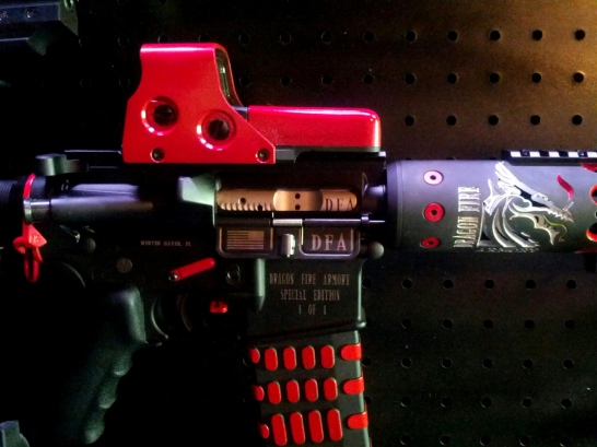 Gun painted with red and white accents