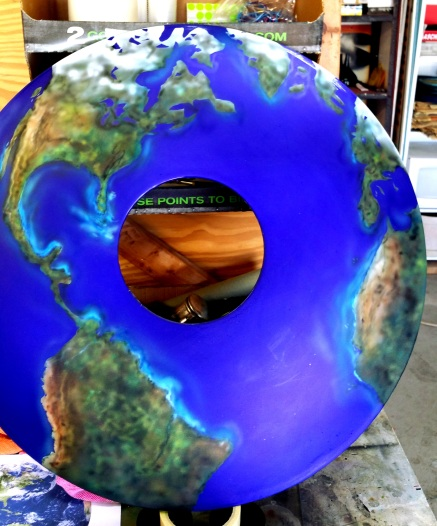 Earth Airbrushed on wheel cover.