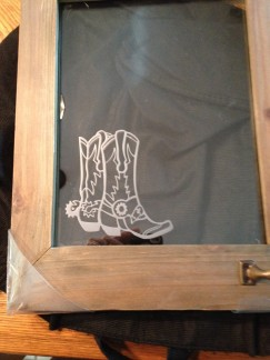 Etched boots on glass frame