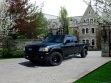 Truck now in front of a rich $$ home