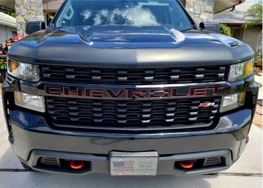 Grill Letters outlined in red on GMC