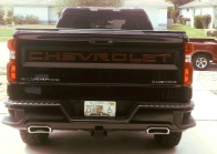 Raised tailgate letters painted red on GMC