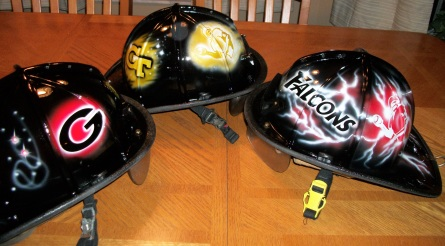 fireman helmets with football logos airbrushed