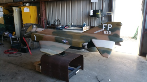 fiberglass repair on large model jet, with spot touch up of colors