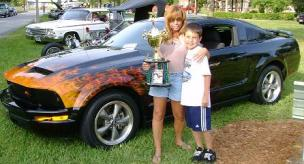 True fire on Mustang with proud owner winning a trophy.