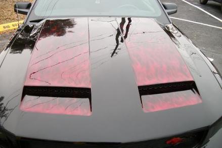 Red true fire race stripes on Mustang hood