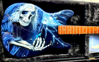 Rocker Skull on Guitar