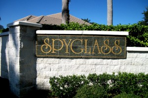 Gold inlay on tile signs at entrance to community in Trinity FL