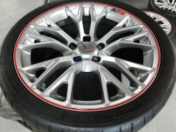 Red pinstripes painted on Vette wheels