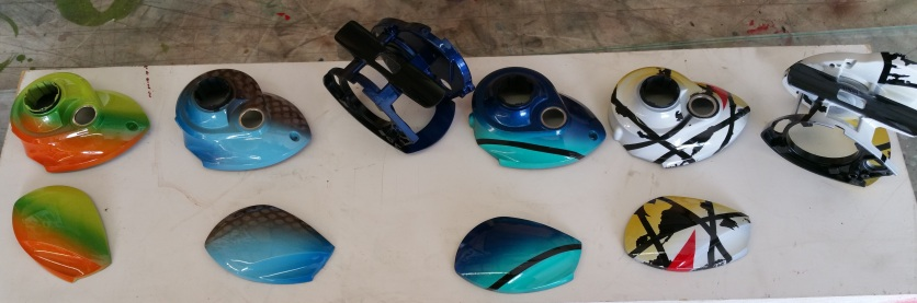 Fishing reels for 13 Fishing co. Airbrushed and ready for assembly