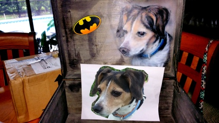Portrait of pet dog with original photo displayed