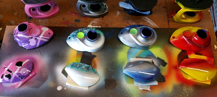 Airbrushed fishing reels ready for assembly. for company called 13fishing