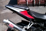 Yamaha with red and silver graphics.