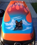 Cabota Tractor hood. Airbrushed flames and pet portrait of owners dog.