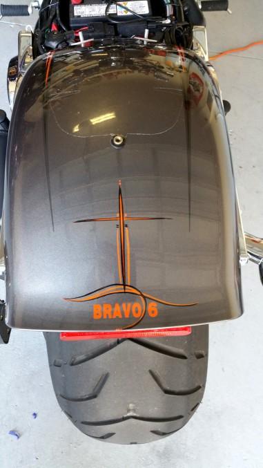 orange and black pinstripes on Harley