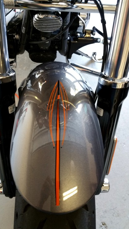 orange and black pinstripes on Harley
