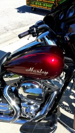 3 tone pinstripes and graphics on Red Candy Harley. with airbrushed Harley Logo