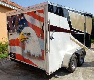 Flag and eagle head on rear of trailer