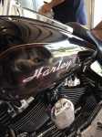 Airbrushed matching fire and lettering on Harley Motorcycle