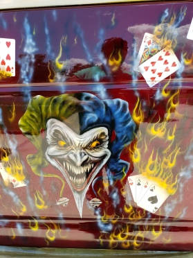 Joker and flaming cards on van rear door