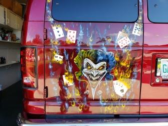 Joker and flaming cards on van rear door