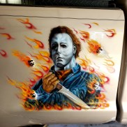 Michael Myers on side of truck