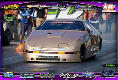 Race car with airbrushed front on track